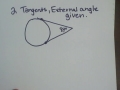 Finding arc measure of a circle using tangent lines