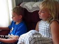 6 year old reads to his younger sister
